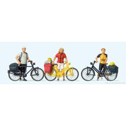 Standing cyclists.