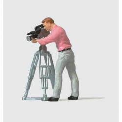 Camera man with movie camera.