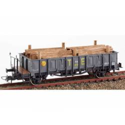 "RENFE open wagon ""X1"" with timber load."