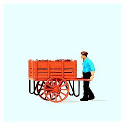 Worker with hand cart.