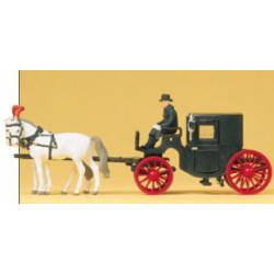 Horse drawn black coach.