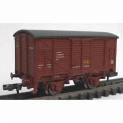 Vagón unificado cerrado rojo óxido.