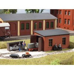 Narrow gauge engine shed with service station.
