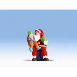 Papa Noel con niño.