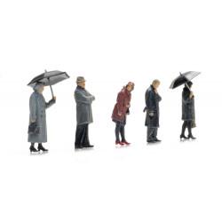Passengers in rain.